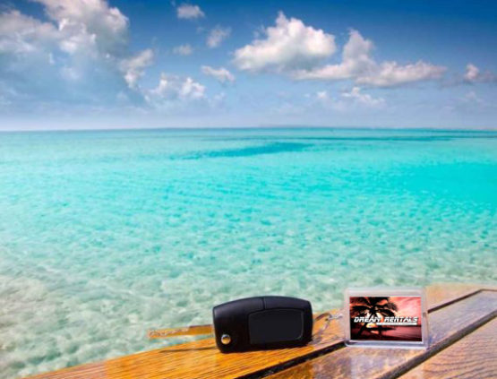 car-keys-and-keychain-on-wooden-table-overlooking-caribbean-sea-with-logo